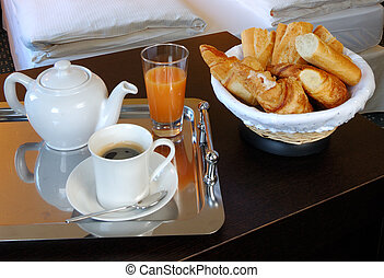 a french breakfast served into a hotel bedroom at Paris