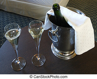 iced bucket of Champagne - A iced bucket of Champagne with...
