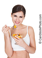 Healthy Woman Eating Fruit Salad