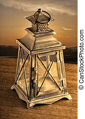 Lantern - Old lantern in sunset light over a wooden table