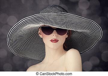 Fashion women in wide hat