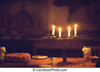Retro candle and cake on table. Photo in old vintage style.