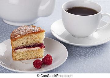 Tea and Victoria Sponge - A cup of tea served with fresh...