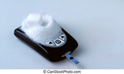Sugar cube falling onto pile of sugar on blood glucose...