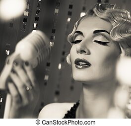 Monochrome portrait of elegant blond retro woman singer with...