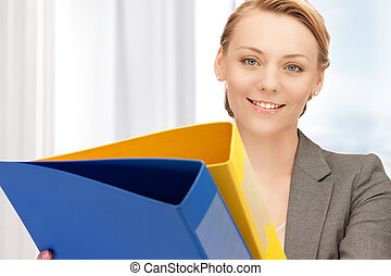 woman with folders - bright picture of beautiful woman with...