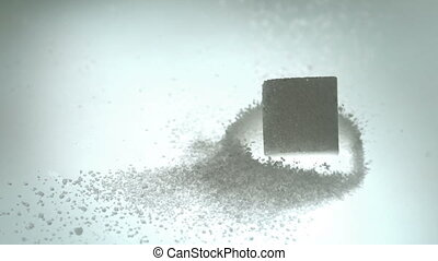 Sugar cube falling onto pile of powdered sugar in slow...