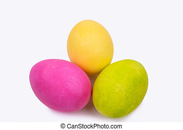 three painted Easter eggs on a white background