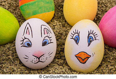 two cute eggs with painted Easter bunny and chicken