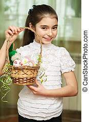girl with a basket of Easter eggs