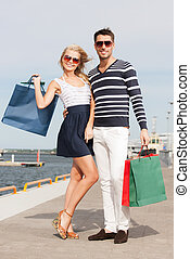 young couple in duty free shop - picture of happy young...