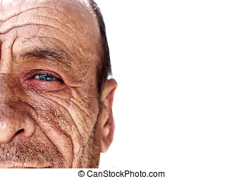 Old wrinkled man against white background