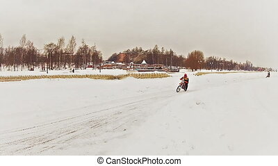 Motorcross riders training on ice - PETROZAVODSK, RUSSIA -...