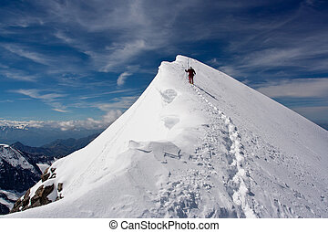 Descending climber - Climber descending snowy peak at...