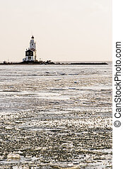 A beautiful beach and lighthouse at sunrise (Marken The Netherlands)