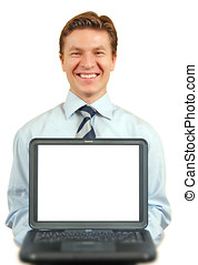 Young businessman presenting a laptop , laptop screen clipping path included