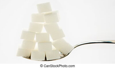 Sugar cubes vanishing from teaspoon in stop motion