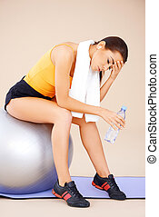 Woman sitting on fitness ball - Young beautiful Woman...