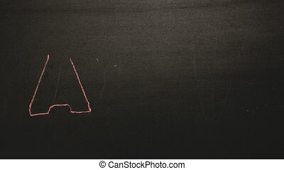 Abc appearing drawn on blackboard with chalk in stop motion