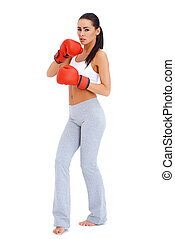 Full body shot of a woman wearing boxing gloves
