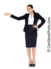 Business woman standing and pointing at copy space - Young...