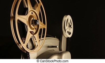 Film Spools on Projector - Close-up on the spinning film...
