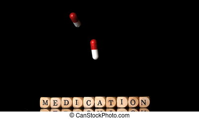 Capsule tablets falling in front of