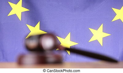 Focus on gavel and sounding block with european union flag...