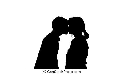 Making Out Silhouette - Shy boy leans in for a kiss, girl...