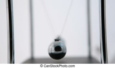 Perpetual motion of newtons cradle on white background