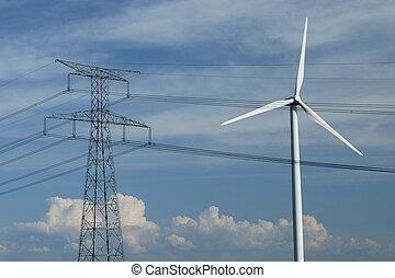 a windturbine close to a electric pylon in France