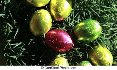 Easter eggs packed in aluminium red yellow and green