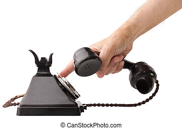 Old Telephone - Hand holding the receiver and dialing an old...