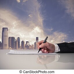Businessman is signing a contract in office
