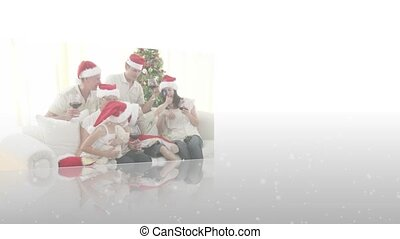 Montage of family celebrating christmas on white background