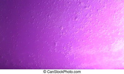 Water spreading on purple background