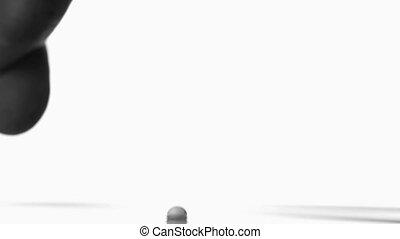 Finger splashing drop against white background
