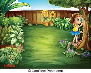 A little girl studying the plants in the garden