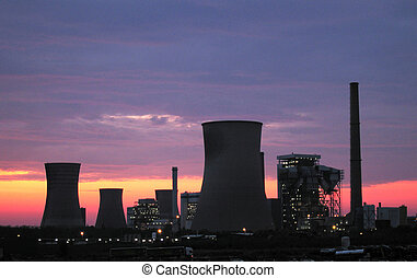 power plants at the sunrise - silhouette of Coal fired power...