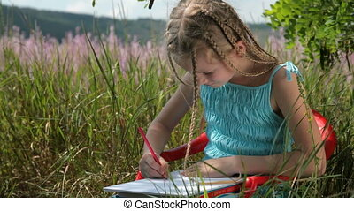 Child drawing with colored pencils - Little girl drawing...