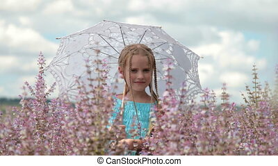 Little girl with lace parasol - Little blonde girl with a...