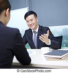 asian business people - asian business executives having a...