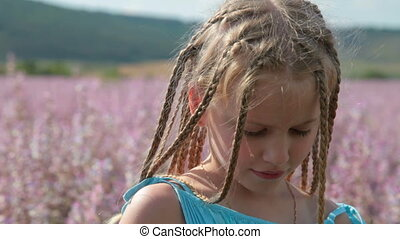 Child with camera - Little girl with a camera on blossoming...