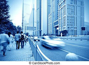 Shanghai street and pedestrian - passenger walking on the...