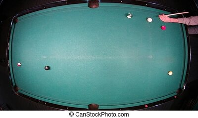 Father with son play on billiards on big table with green...