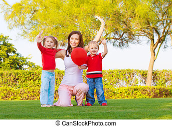 Happy family in spring park - Photo of pretty mother with...