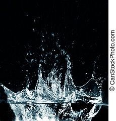 splash in water with drops on black background