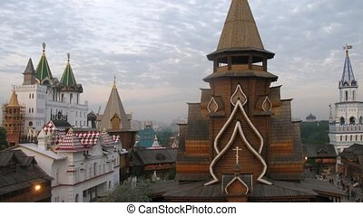 Roofs of Old Russian buildings stand against cloudy sky,...