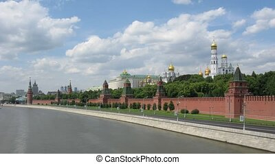 Towers of Kremlin and domes of churches stand against Moscow...