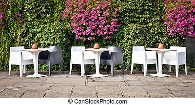 Outdoor cafe - A modern set of tables and chairs outside a...